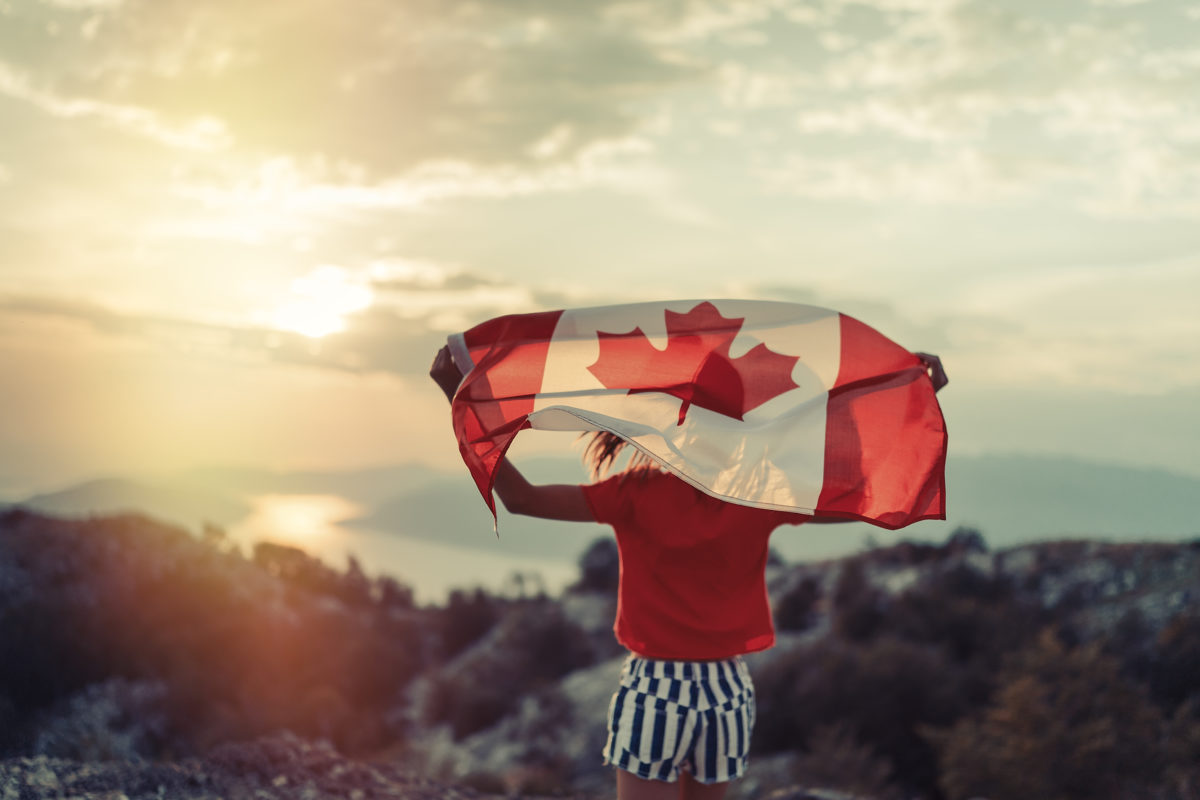 Settlement, social service, sun shining onto a house, girl holding Canadian flag